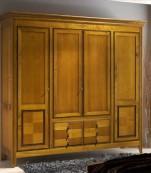 Armario cuatro puertas tres cajones